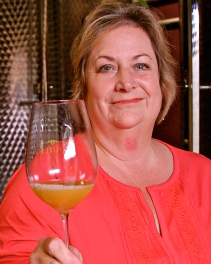 Acquiesce's Sue Tipton with just-pressed Piquepoul Blanc (picked September 13)