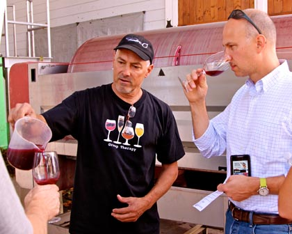Macchia's Tim Holdener sampling visitors with just-fermented and pressed Zinfandel juice last week
