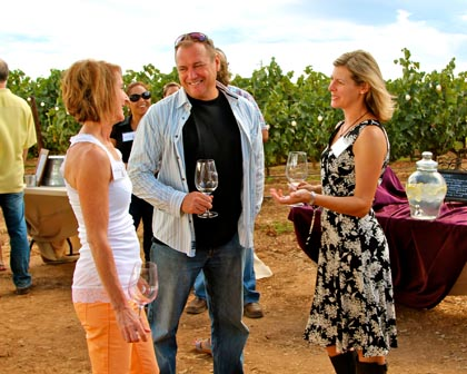 Late August: Estate Crush owners Sandy Sikeotis, and Bob & Ali Colarossi at Bokisch Ranches' harvest party