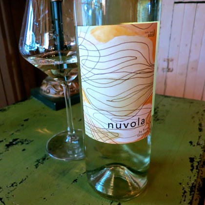 "The art label for Borra's nuvola (Italian for ""sky"") expresses the light, feminine, cloud-like qualities of the wine"