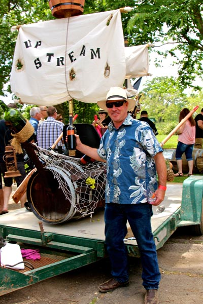 Watts Family owner/grower Craig Watts with his lavish barrel boat…