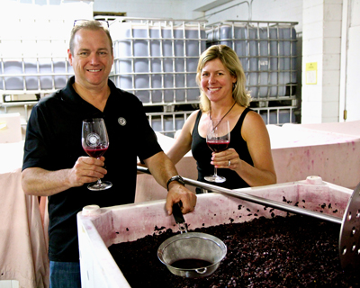 Estate Crush's Bob and Alison Colarossi, tasting their estate grown Stellina Zinfandel, just finishing native yeast open top fermentation on September 5th