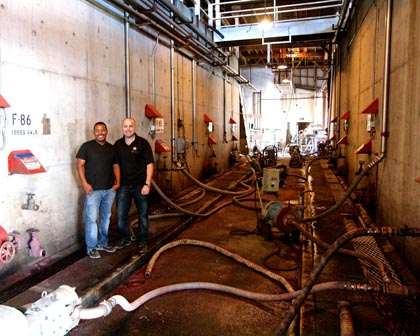 Joseph Smith (left) and Tyson Rippey among the concrete fermentors at The Lodi Vintners Group winery
