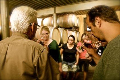 Visiting wine lovers enjoying barrel tasting at Lodi's St. Jorge Winery