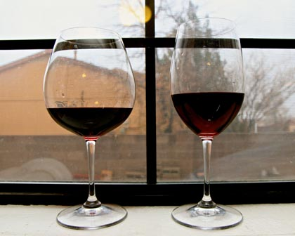 "Comparison of bowl shaped ""Burgundy"" glass (on left; ideal for Pinot Noirs) with traditional tulip shaped glass (ideal for white wines and reds wines such as Zinfandel and Cabernet Sauvignon)"