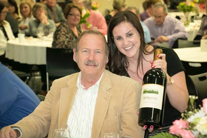 March:  Bruce Mettler shows off his winning bid at the San Joaquin Farm Bureau's annual wine auction.