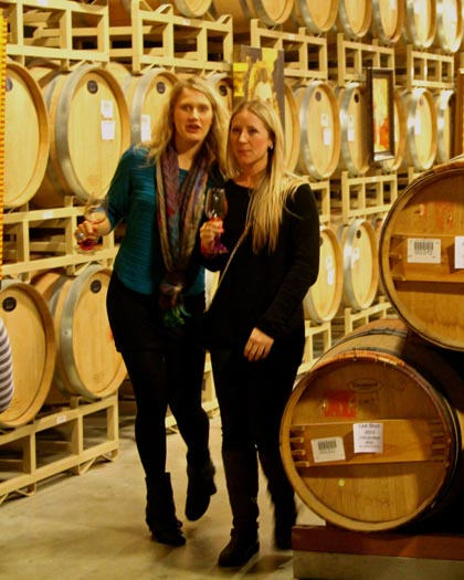 Wine lovers strolling through LangeTwins' barrel room…