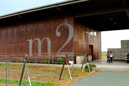 m2 winery's earthen rust colored exterior…