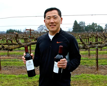 Jason Mikami with his Mikami Vineyards Zinfandel