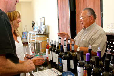 Gus Kapaniaris pouring and chatting with Stama wine lovers
